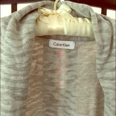 """✨Calvin Klein Grey/Grey Tiger Striped Cardigan✨ ✨Calvin Klein✨ Trendy Chic """"Grey on Grey"""" Cardigan with Subtle Tiger Striped Pattern! Very Cute & Unique! Lightweight Knit & Open In Front. Perfect For Spring/Summer Weather✨Length is 31""""  Sleeves are 3/4 Length. Very Good Preowned Condition!✨✨ Calvin Klein Sweaters Cardigans"""