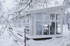 Swedish glass summer house in winter. Still looks inviting.