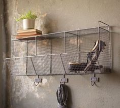 "Reminiscent of vintage gym locker room bins, this retro style wire wall storage shelf offers the perfect solution for just about anything. Keep wash towels and soaps close at hand in the bathroom, organize herbs and spices in your farmhouse kitchen, or create vintage style storage for your mudroom. The Wire Locker Basket Storage Bins feature a top shelf, three cubby spaces and three coat hooks. 33""L x 10.5""W x 18.5""H"