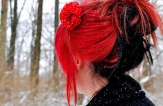 If you're going to go bold with your hair colour, lipstick red and jet black definitely make a cool statement.