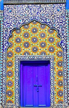 Islamic Doors.  No information provided as to place or date but I adore the vibrant color and shape of the decorative borders. Islamic art by Iqbal Khatri, via Flickr Added November 8,2013 style, color, architecture