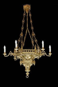 A good gilt bronze Gothic chandelier retaining fine original chains, the ceiling crown castellated, the main body with elaborate pierced borders, the whole in good condition. The earliest candle chandeliers were used by the wealthy in medieval Chandelier Pendant Lights, Beautiful Chandelier, Chandelier Lamp, Chandelier Lighting, Beautiful Lamp, Lights, Gothic Chandelier, Beautiful Lighting, Chandelier