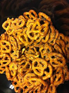 seasoned pretzels (also can use oyster crackers or saltines) - so easy and so good!     1/2 cup canola oil  1 packet dry ranch dressing mix  1 Tbsp lemon pepper  1Tbsp garlic powder  1 tsp cayenne pepper  1 lb pretzels    Mix the seasonings with the oil. Put the pretzels in a resealable gallon-sized baggie. Pour the oil over the pretzels. Seal the bag and shake to coat the pretzels.