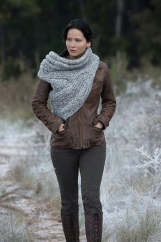 Jennifer Lawrence as Katniss in Catching Fire. Obsessed with this knit scarf sweater thing, need!!