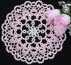 A touch of Pink Floral Doilies FCDS04 6 pretty doilies to decorate your home. Doily sizes range from 9.75 inches to 22.5 x 17.7 inches. Each doily concentrates on a different technique ranging from Crochet Tatted Lace, Rick Rack Crochet, Bruges Lace, Irish Lace cords, Filet and Rice stitch(bullions) doilies. Publication produced by Ferosah Crochet Design Studio, Release date is July 15th 2008