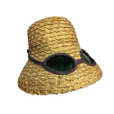 A fantastic whimsical novelty straw hat from the 1950s from Joyce. Flowerpot shaped straw with inset trompe l'oeil sunglasses.