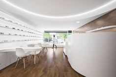 Image 7 of 34 from gallery of Optical Pitães / Tsou Arquitectos. Photograph by Ivo Tavares Studio Pharmacy Design, Cool Store, Store Design, Interior Architecture, Gallery, Furniture, Photograph, Studio, Space