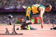 A photo for the history books... Oscar Pistorius of South Africa became the first double-amputee runner to compete in the Olympics.  He finished second in his heat of the 400 meters and advanced to the semifinals.