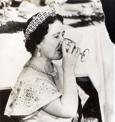 The Queen Mother Elizabeth in a classic pose as she sips on a glass of wine. Description from lordsofthedrinks.com. I searched for this on bing.com/images