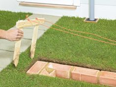 How to Build a Brick Garden Wall : How-To : DIY Network