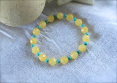 Yellow Calcite Robin Blue Magnesite Beaded Bracelet  Aids in creative visualization during meditation and protection during shamanic work.