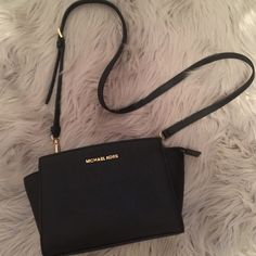 Michael Kors Mini Selma Crossbody Black Michael Kors Mini Selma Crossbody with strap!  Gold hardware detail and in EUC.  One minor flaw is on the corner, tear on the lining-barley noticeable (see photo 4) This bag goes with everything!  Also, please ignore my nails in photo #3 lol Michael Kors Bags Crossbody Bags