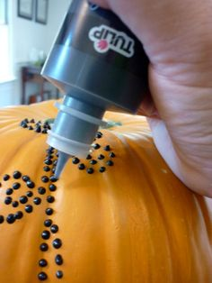 Pumpkin decorating with a twist!  Made with Tulip puffy paint.