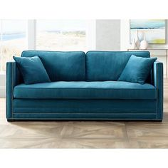 Cozy up in this handsome contemporary velvet sofa in a wonderful medium blue.