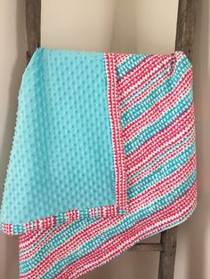 A personal favorite from my Etsy shop https://www.etsy.com/listing/226624543/blue-and-pink-baby-girl-blanket-minky