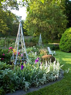 Who wouldn't be inspired by this stunning garden? Find more beautiful outdoor spaces: http://www.bhg.com/gardening/?socsrc=bhgpin071312minitrellises
