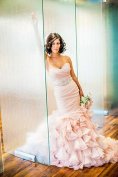 This is so gorgeous! A soft pink wedding dress, we absolutely love this idea food beyond the classic white traditional. What do you think?!