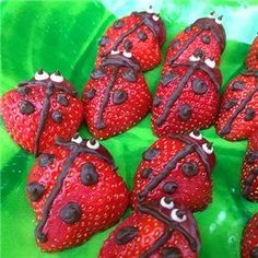 http://www.partyideasuk.co.uk/library/party-themes/bug-party-ideas/party-food/strawberry-ladybirds.aspx