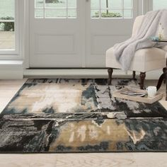 Anchor your parlor or dining room ensemble in artful style with this eye-catching area rug, featuring a bold patchwork motif for a dash of abstract appeal. #artful #ensemble #eye