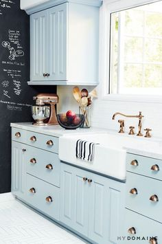 Robins egg light blue cabinets, copper hardware, farmhouse sink // kitchen renovation inspiration