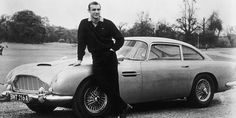 This Month in Automobile History ~ The Aston Martin, a True Sports Car was built ~ Photo Credit Sean Connery as James Bond in Goldfinger with Aston Martin, Photograph: Everett Collection / Rex Features Aston Martin Db5, Bmw I8, Gq, Famous Movie Cars, Film Cars, Sean Connery James Bond, James Bond Cars, Iconic Photos, Latest Cars