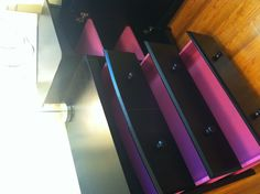 DIY: Painted with a touch of pink to insides of drawers to brighten black nursery furniture.