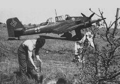 A crew member of the German dive bomber Ju-87 washes personal belongings