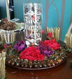 Decor for my wedding I made using moss, acorns n silk flowers