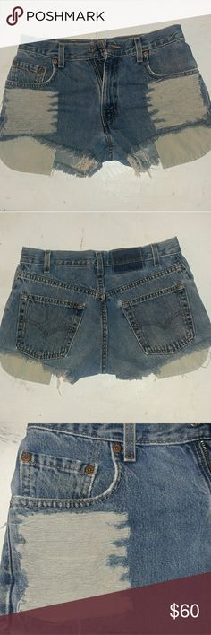 "Vintage High waist Levi DIY denim shorts These denim cut-off shorts hair DIY super cute for summer is short still have life to them.. size says 28 but can fit either a 26 to 27.. please check the measurements to make sure it will fit Measurements laying flat 14 1/2"" waist 10"" Outer seam 2"" inseam 10"" rise Levi's Shorts Jean Shorts"
