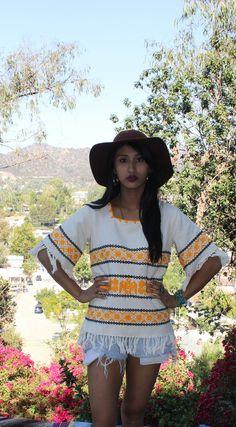 Beautiful Gypsy Hippie Vintage Handwoven Guatemalan Tunic Top 1960s 1970s Fringe. $38.00, via Etsy.