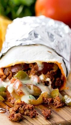 Chorizo, Potato, and Queso Burritos....hmmmI could replace the chorizo with tofu or possibly black beans to make it vegan friendly.