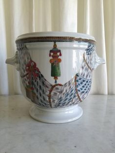 Check out this item in my Etsy shop https://www.etsy.com/listing/583508726/fine-porcelain-cachepot-planter-pierre