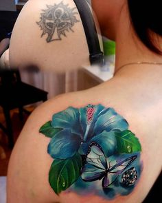 The old tattoo is rather simple to cover up, but get that opportunity to cover it up and make a much more beautiful design. Here, an old tattoo turns into a realistic and beautiful Hibiscus flower and butterfly.