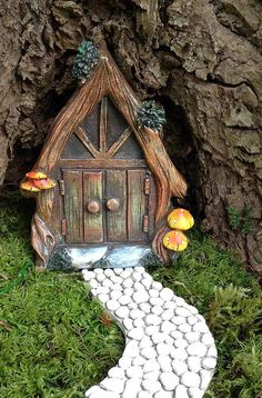 This fairy door with will turn any tree stump in your garden into a whimsical gnome home! The door measures just over wide, and 5 tall. It is made from resin, and will hold up well in your outdoor fairy garden (care should be taken in the winter, you m Fairy Tree Houses, Fairy Garden Houses, Fairy Garden Doors, Fairy Doors, Decoration Shabby, Fairy Furniture, Miniature Furniture, Tree Stump, Garden Care
