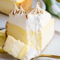Lemon Meringue Cheesecake This Lemon meringue pie cheesecake is decadent and rich - a lemon cheesecake with a ribbon of homemade lemon curd running through the middle, another layer of lemon curd spread across the top. Lemon Desserts, Lemon Recipes, Just Desserts, Sweet Recipes, Dessert Recipes, Cream Cheese Desserts, Meringue Desserts, Baking Desserts, Lemon Mirangue Pie Recipe