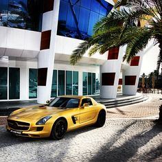 Gold Mercedes Benz SLS