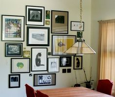 Cluster of frames for wall next to the desk.  It adds visual interest if the frames are different shapes and sizes, and mattes are different widths.  But this is not necessary, just as long as there are common elements among the pictures (like in this instance the black in the frames.)