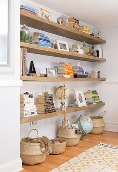 How to Build Floating Shelves for Uneven Walls Learn how to build floating shelves and all my tips and tricks for DIY floating bookshelves. Get a totally modern, minimal, beautiful wooden shelving system to organize a living room or any room in your home! Floating Bookshelves, Wood Bookshelves, Floating Shelves Diy, Ideas For Bookshelves, Living Room With Bookshelves, Diy Wooden Shelves, Timber Shelves, Diy Bookshelf Design, Diy Bookshelf Plans