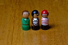 So cute.  Could make or order from here...  Peter Pan and Pirates Wooden Peg Dolls. $15.00, via Etsy.