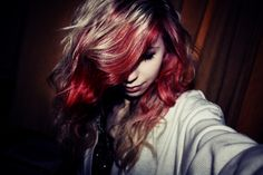 Wavy brown hair with red streaks