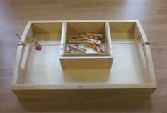 Montessori DIY Practical Life placing mini clothespins onto a line strung across a tray.