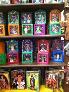 Saints and Luchadores in brightly colored shadow boxes.