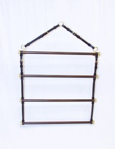 Classic leather, wood and brass blanket rack - available at The Castleton House and Gallery ltd.