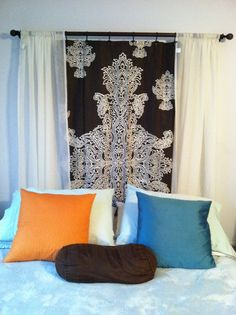 Using a curtain rod to create a headboard... Love this one! The middle section is a shower curtain, the outside sections are sheer curtains.