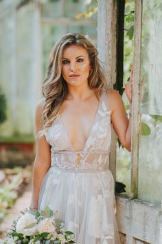 Galatea by Willowby A-line silhouette, sofy and floaty with Floral motifs. Two rows of Velvet Ribbon wrap around the bodice to secure the waist with a delicate bow in the back. Perfect for the modern bride/boho bride who wants something a little different