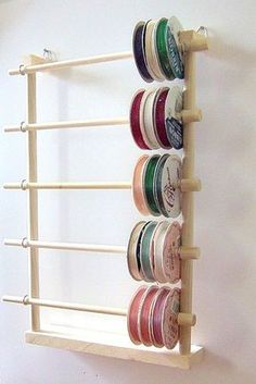 Now you can organize your favorite ribbons spool after spool without a tangled mess!    This one HANGS on your wall or door! Save even MORE space!