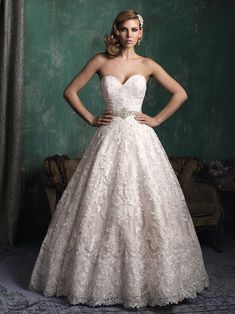 Yes! Say hello to this classic lace ball gown. How pretty! Dress: Allure Couture 2015