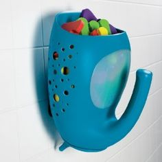 This is a great bathtub toy holder.  It's cute and functional.  We use it to scoop up BabyBear's tub toys and then hold it under the faucet to rinse off soap and tub muck.  There are holes all over the sides and bottom that allow for water to drain out.  It comes with a couple different ways to attach it to your tub.  We use the suction cup attachment and it holds very well.