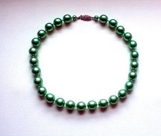 Vintage Choker / Necklace with frosted green glass beads and a classic embellished clasp set with three crystal diamanté. The necklace is