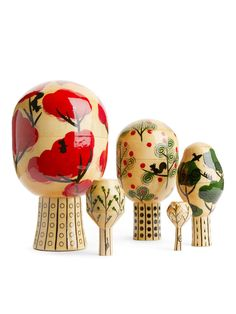 A decorative set of five hand painted nesting trees with various patterns. The design is based on the traditional manufacturing skills of Russian matryoshk